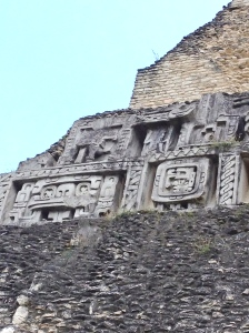 A Frieze carved into the side of a pyramid at Xunantinich, Belize.